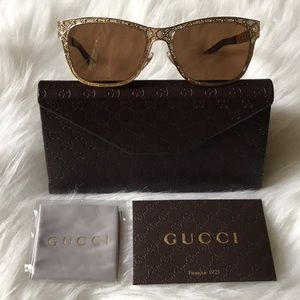 Authentic Gucci sunglasses in gold frame with GG